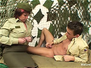 Mature officer ravages her new recruit